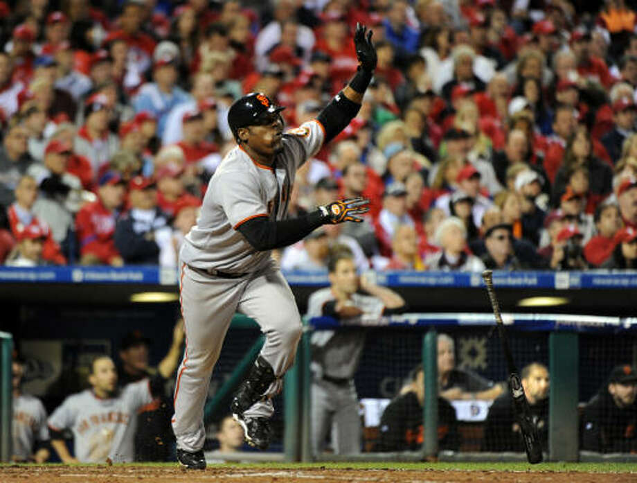 The Giants' Juan Uribe hits an eighth-inning home run to help clinch a World Series berth. Photo: Karl Mondon, MCT