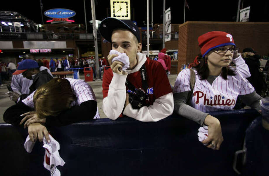 The Philly faithful is dejected after seeing their team fall 3-2 to the Giants on Saturday night. Photo: Eric Gay, AP