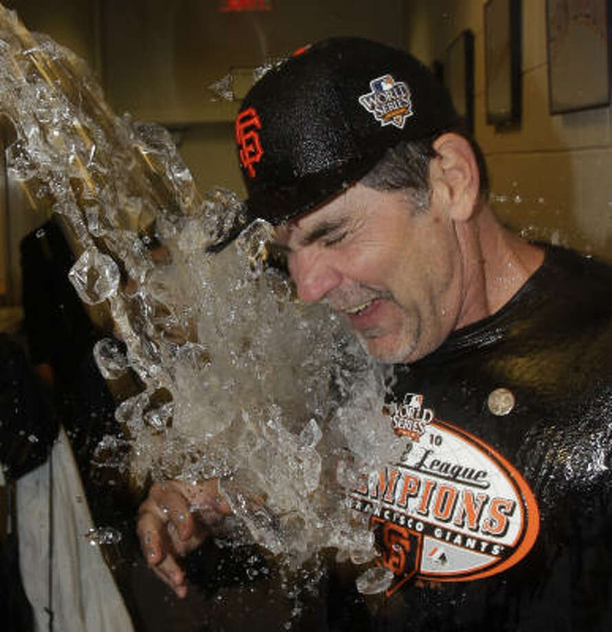 Giants manager Bruce Bochy celebrates his team's 3-2 victory over the Phillies in style. Photo: David J. Phillip, AP
