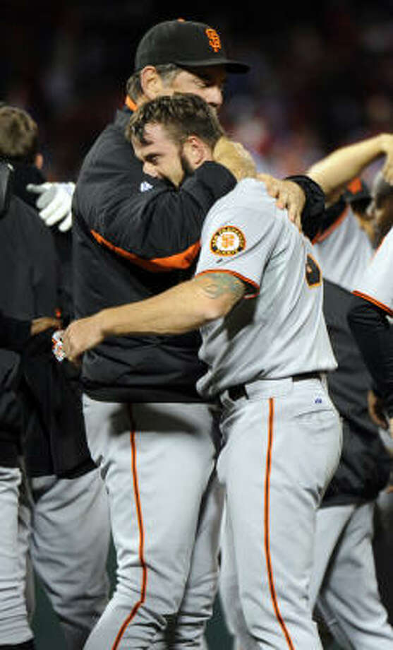 Giants manager Bruce Bochy, left, hugs his closer Brian Wilson after winning the National League pennant. Photo: Karl Mondon, MCT