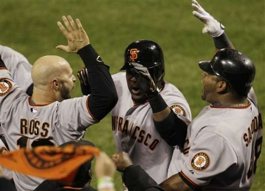 They are celebrating in San Francisco after the Giants' 3-2 win over the Phillies to clench a spot in the World Series. Photo: Eric Gay, AP
