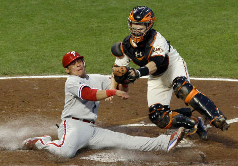 Giants catcher Buster Posey tags out Philadelphia's Carlos Ruiz at home plate during the fifth inning. Ruiz had been trying to score from second base on a hit by Shane Victorino. Photo: Eric Risberg, AP