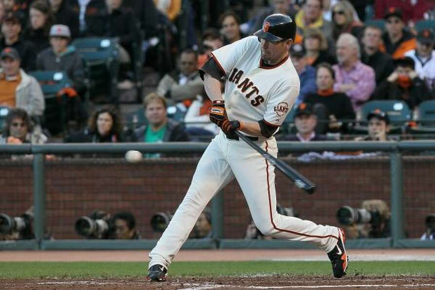 San Francisco's Aubrey Huff singles off Phillies starter Joe Blanton in the third inning.