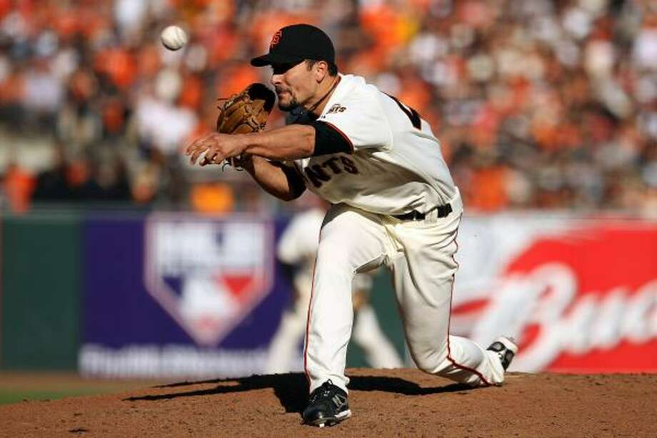 Javier Lopez pitched the eighth and Brian Wilson finished it for his fourth postseason save and second in as many tries this series. Photo: Ezra Shaw, Getty Images