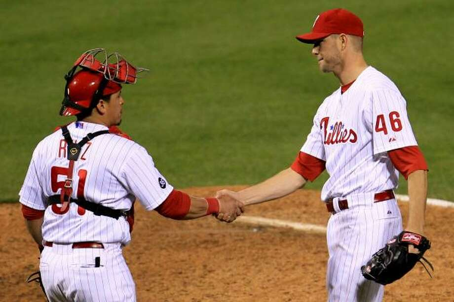 Phillies catcher Carlos Ruiz and closer Ryan Madson celebrate their team's victory. Photo: Chris McGrath, Getty Images