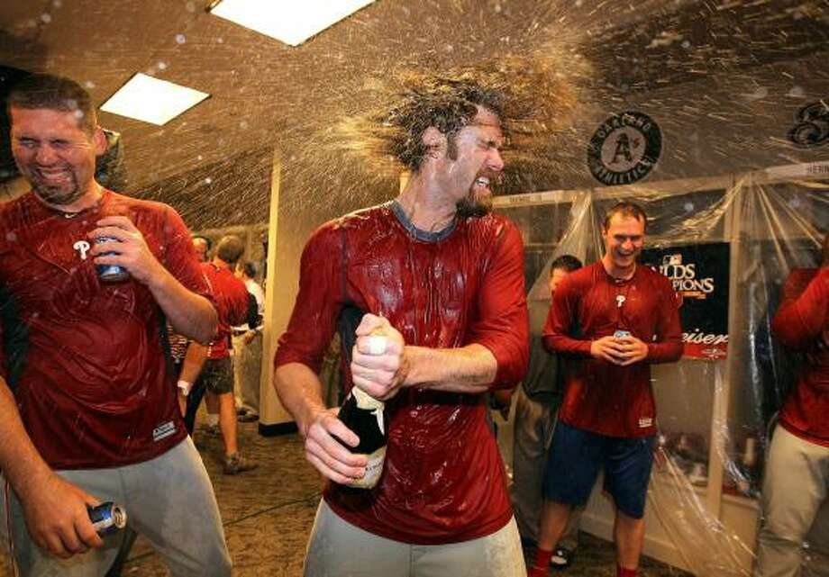 NLDS Game 3: Phillies 2, Reds 0 (Phillies win series, 3-0)Jayson Werth of the Phillies shakes champagne out of his hair in the clubhouse. Photo: Andy Lyons, Getty Images