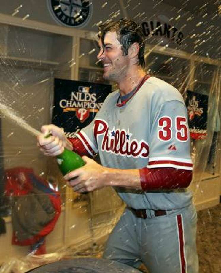 Phillies pitcher Cole Hamels sprays champagne in the clubhouse after throwing a complete game shut-out to sweep the Cincinnati Reds. Photo: Andy Lyons, Getty Images
