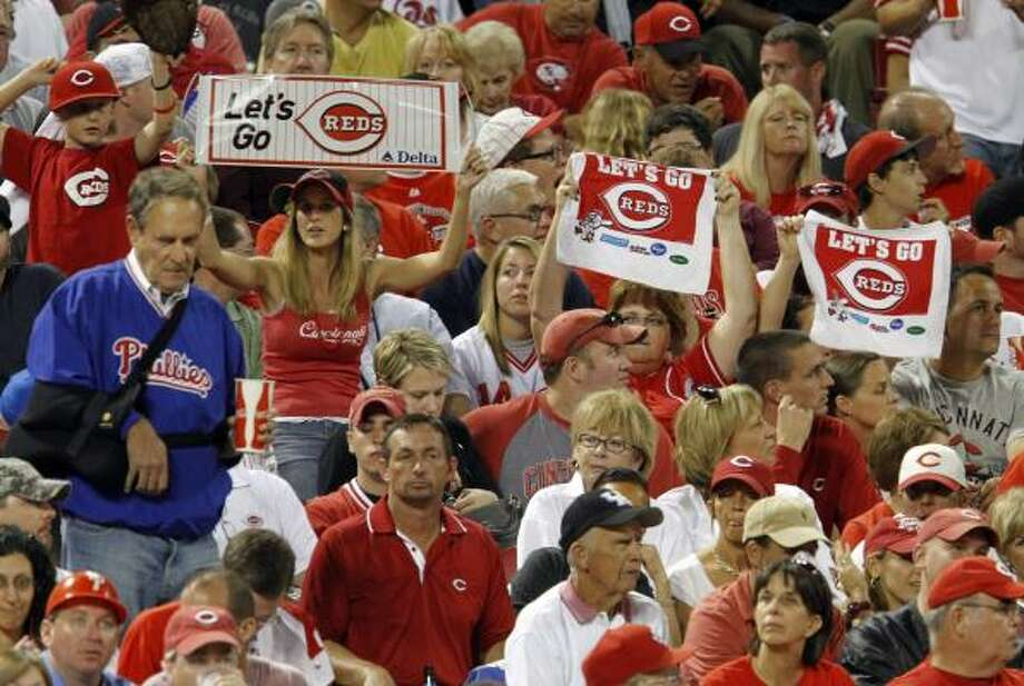 Reds fans try to rally their team in the sixth inning. Photo: Gene J. Puskar, AP