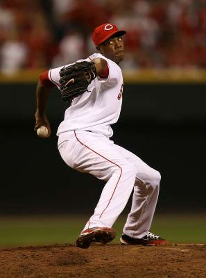 Reds pitcher Aroldis Chapman pitches in the ninth. Photo: Jonathan Daniel, Getty Images