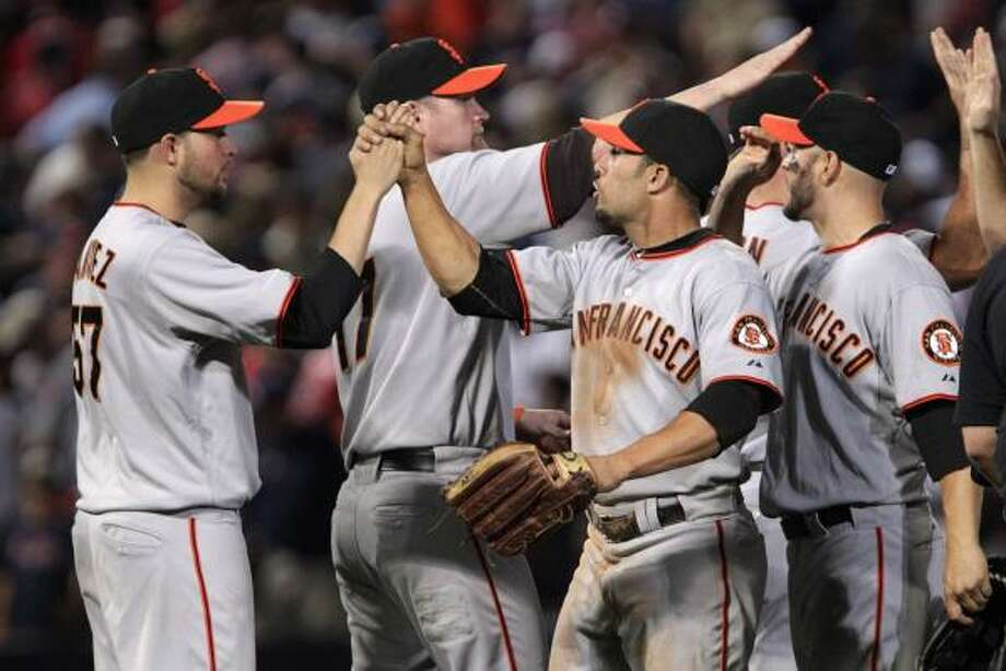 Giants players congratulate one another after the game. Photo: Dave Martin, AP