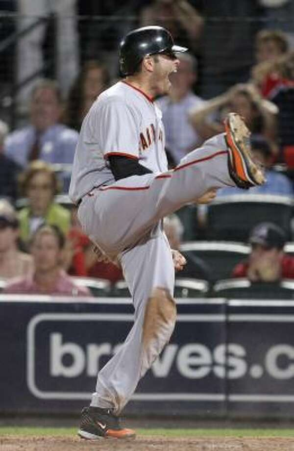 Giants second baseman Freddy Sanchez reacts after scoring the go-ahead run. Photo: John Bazemore, AP