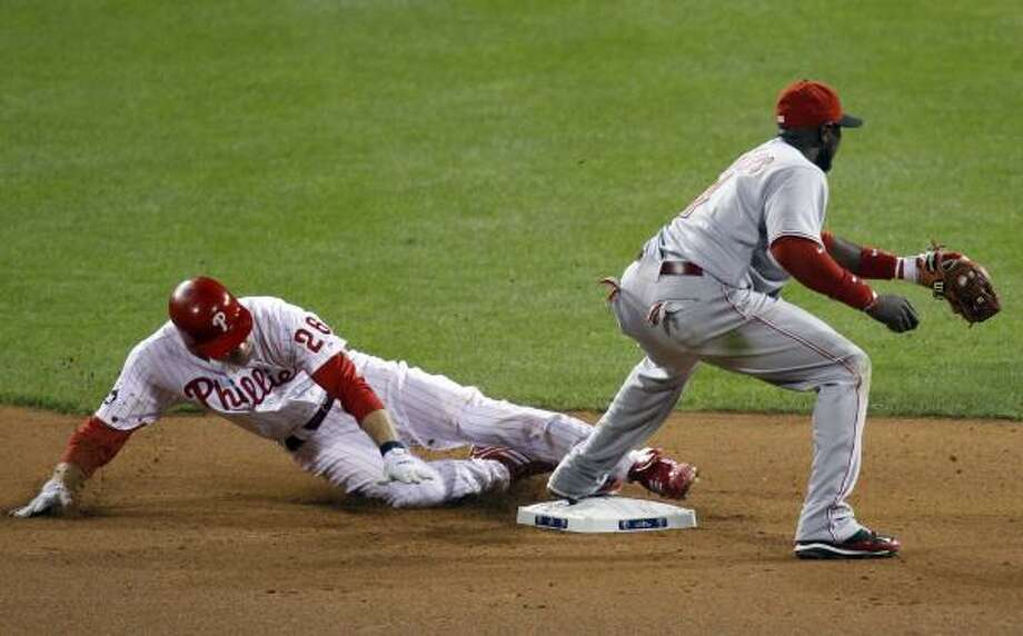 Philadelphia's Chase Utley is safe at second base as Reds second baseman Brandon Phillips steps on the bag during the seventh inning. Photo: Matt Rourke, AP
