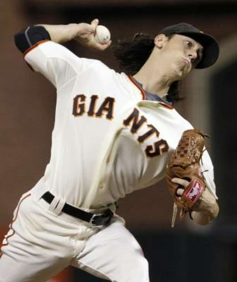 Giants starter Tim Lincecum dominated the Braves in his postseason debut, tossing a two-hit shutout with a franchise playoff record of 14 strikeouts. Photo: Ben Margot, AP