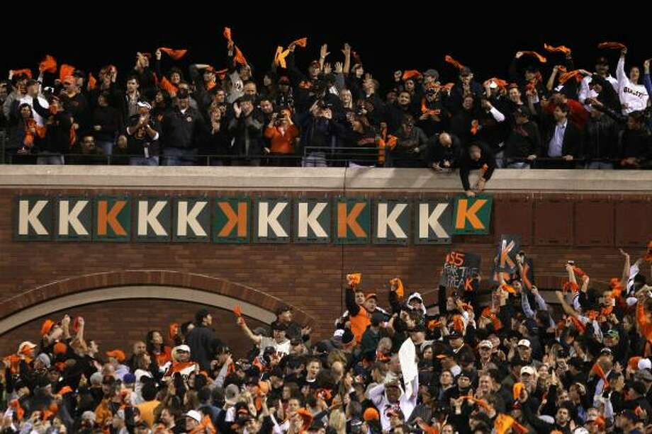 "Fans put up another ""K"" after Giants pitcher Tim Lincecum (not pictured) struck out Atlanta's Eric Hinske to end the eighth inning. Lincecum finished the night with 14 strikeouts, which set a Giants playoff record and tied the major league record for strikeouts in a postseason debut. Photo: Ezra Shaw, Getty Images"