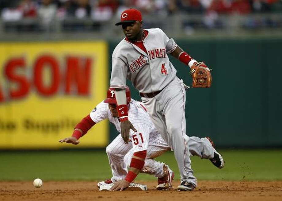 Philadelphia's Carlos Ruiz, left, is safe at second as Reds second baseman Brandon Phillips chases down a throw. Photo: Jeff Zelevansky, Getty Images