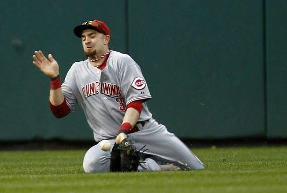 Cincinnati outfielder Jonny Gomes fails to make this catch. Photo: Jeff Zelevansky, Getty Images