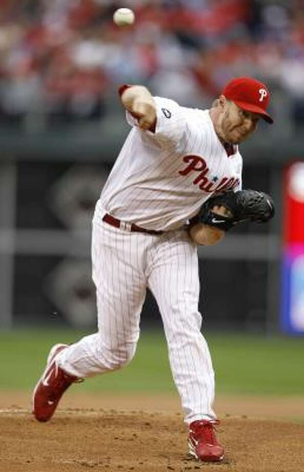 Phillies starter Roy Halladay delivers to a Reds batter during the first inning. Photo: Matt Slocum, AP