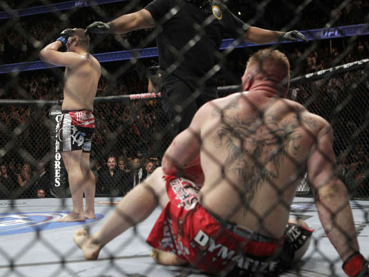 Cain Velasquez, left, celebrates after he defeated Brock Lesnar at the main event of UFC 121 at Anaheim, Calif.