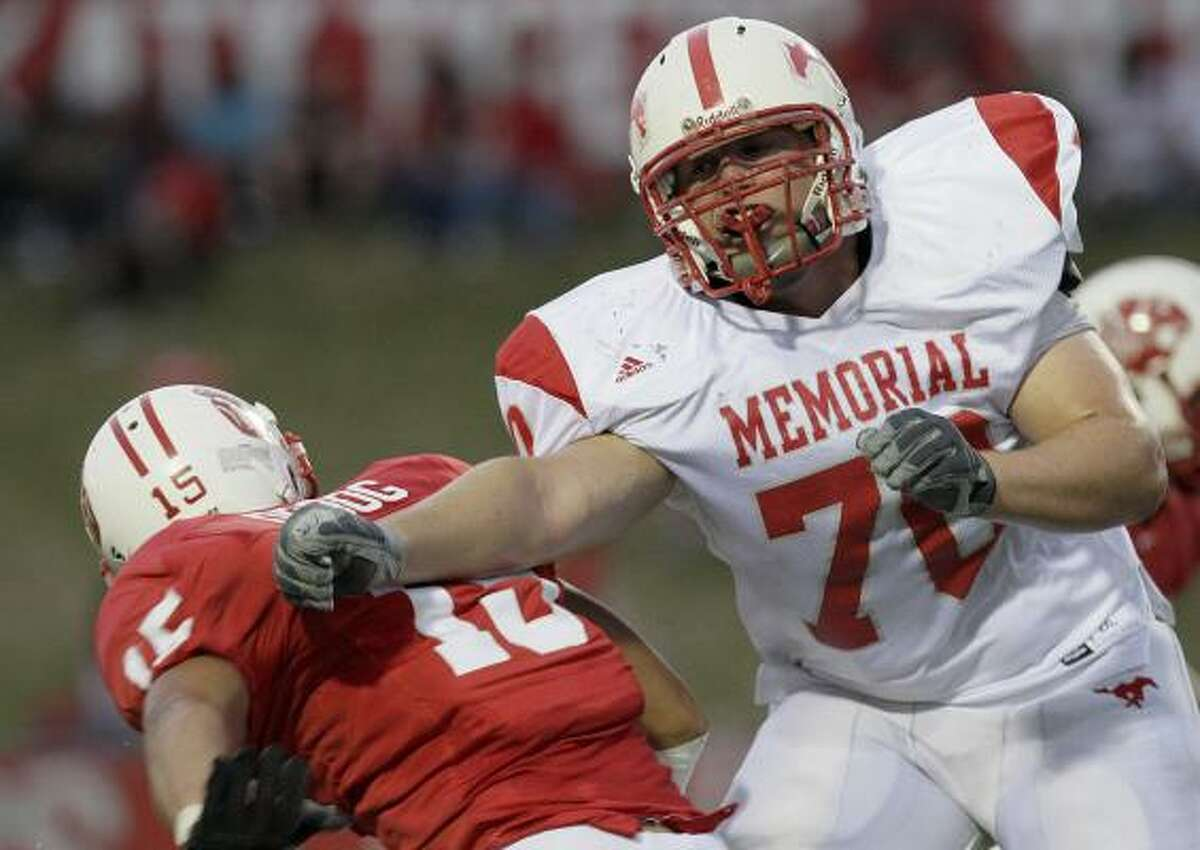 Dylan Guthrie of Memorial trys to bust through the Katy defense.