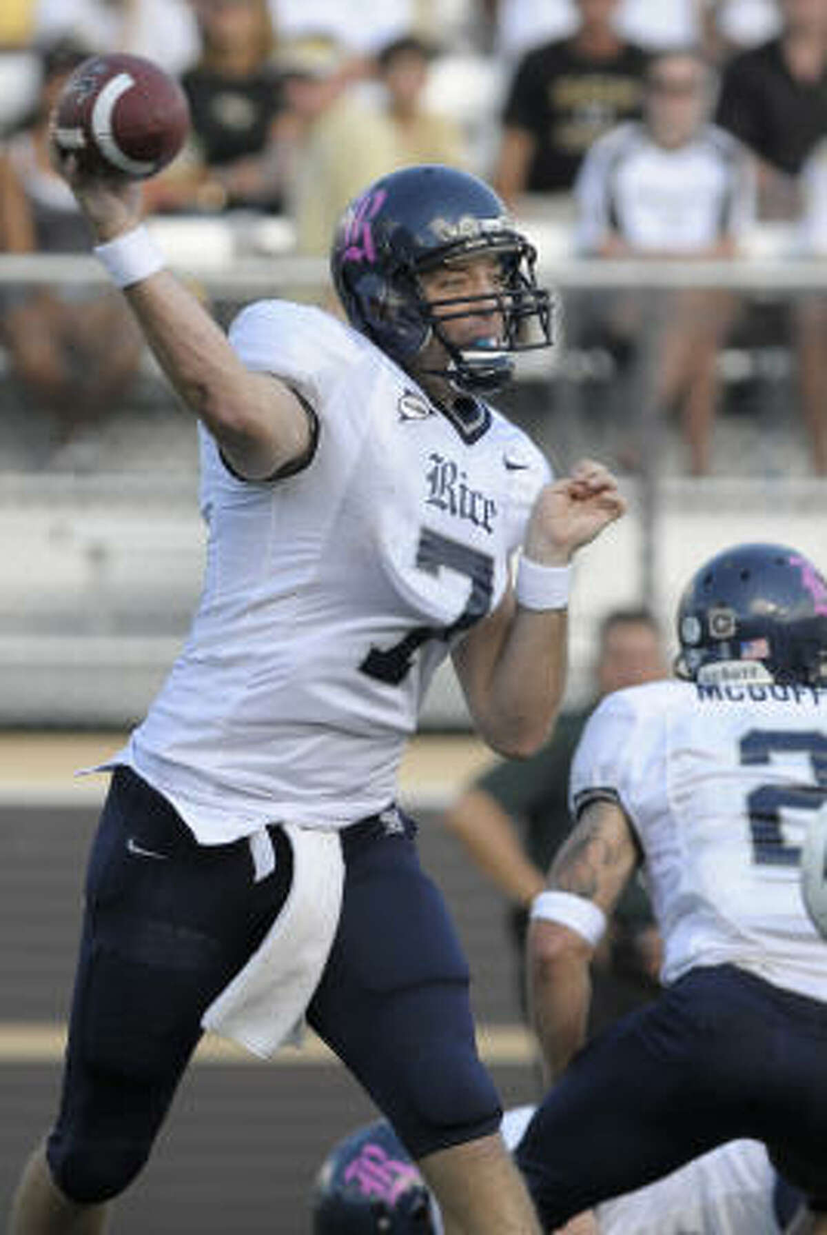 Rice quarterback Nick Fanuzzi, left, throws to a receiver during the first half.