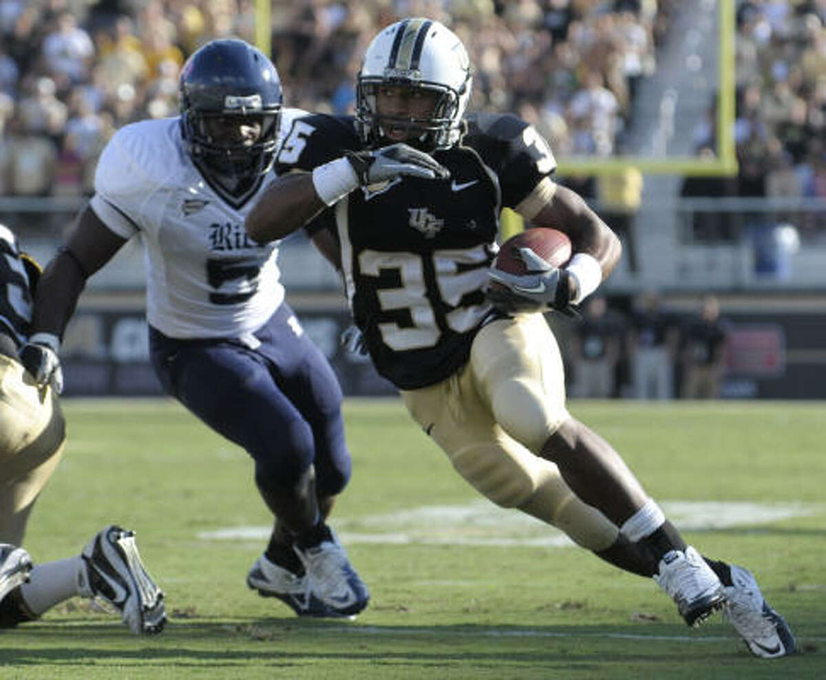 Central Florida running back Ronnie Weaver runs past Rice's Justin Hill.