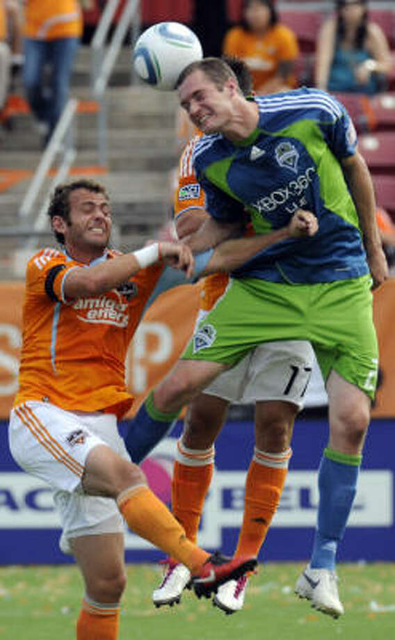Dynamo 2, Sounders 1    Seattle Sounders' Nate Jaqua heads the ball in front of the Dynamo's Brad Davis. Photo: Pat Sullivan, AP