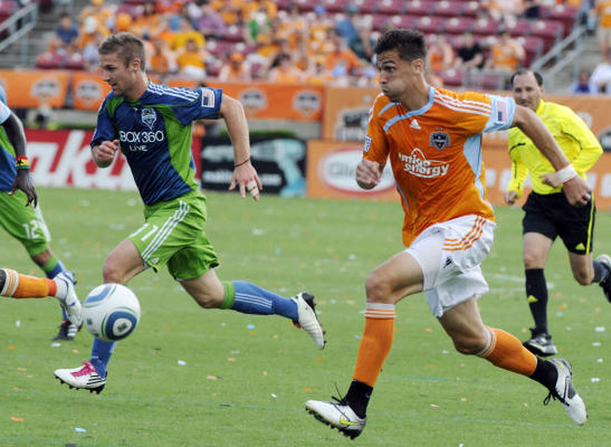 Geoff Cameron and the Dynamo beat the playoff-bound Seattle Sounders 2-1 on Saturday.