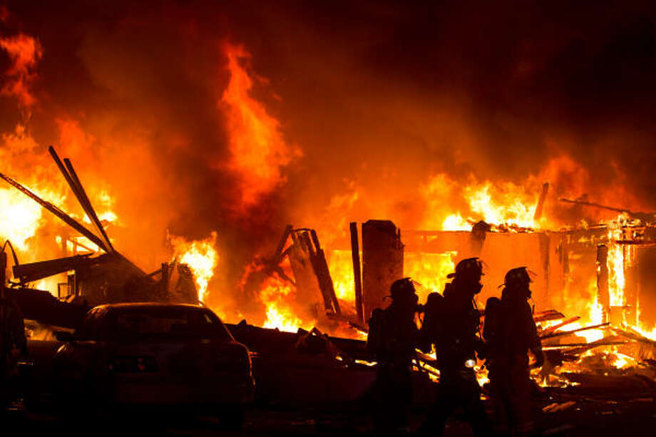 Fire completely engulfs a house in the 800 block of Shawnee St. on Friday night in Houston. Photo: Smiley N. Pool, Houston Chronicle