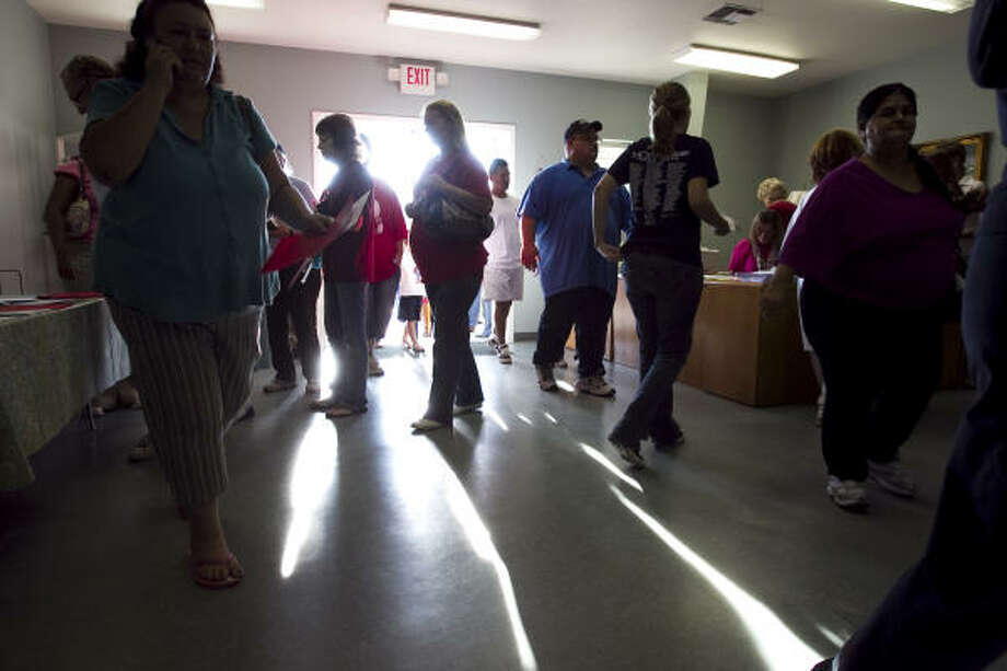 Clients of The Mission, a faith-based organization that helps  the poor get back on their feet, arrive for the day's services in New Caney. Photo: Brett Coomer, Houston Chronicle