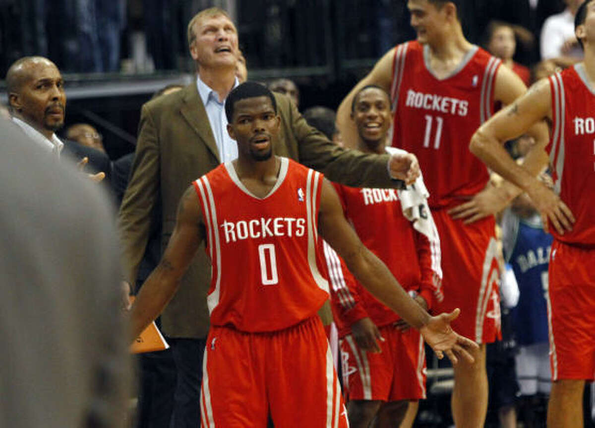 Rockets guard Aaron Brooks (0) looks towards the referees.