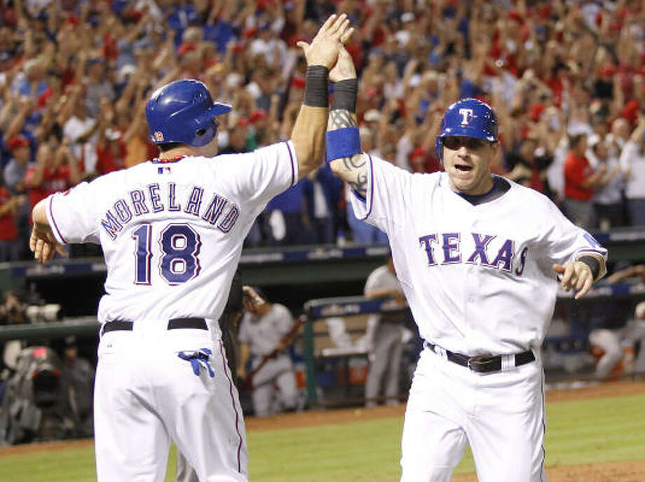 ALCS Game 6: Rangers 6, Yankees 1 (Rangers win series, 4-2)Mitch Moreland (18) and Josh Hamilton of the Texas Rangers celebrate after Hamilton scored in the fifth inning. Photo: Ron Jenkins, MCT