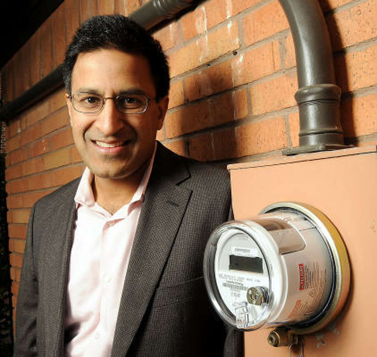 Rakesh Agrawal wants to seeing how CenterPoint's smart meter, above, compares with the system he installed himself. The data from his system has led him to switch to fluorescent bulbs.