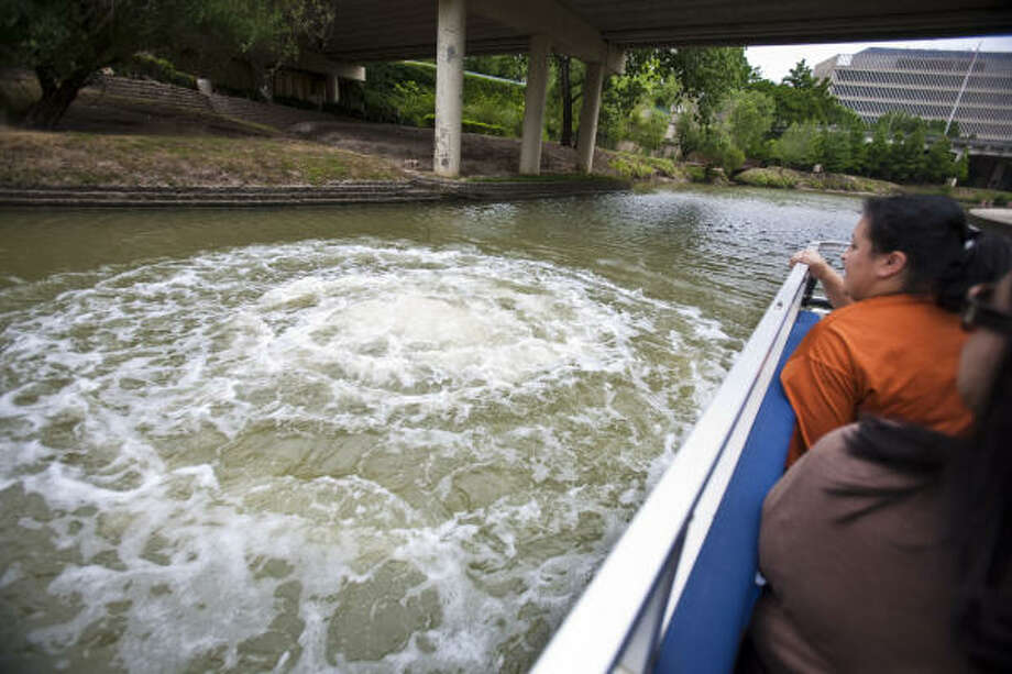 "Click to see Houston ""secrets"" to discover:1. You can ""burp"" the Bayou.But for real: Ever walk by a big red button and be so overwhelmed with curiosity that you want to push it, but can't because you're not sure what it does? Push away, friends! A button hidden inside a pillar of the Preston Street Bridge creates what's called the ""Big Bubble"" in the bayou.Pictured: The Buffalo Bayou Partnership's barge passes an art installation by Dean Ruck, where water bubbles when a button is pressed on Preston Street Bridge above. Photo: Eric Kayne"