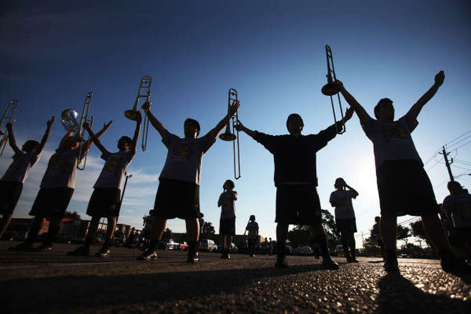 The low brass section rehearse their final set with the rest of the Waltrip Ram Marching Band in preparation for the University Interscholastic League's (UIL) Region XXIII Marching Contest. Photo: Mayra Beltran, Chronicle