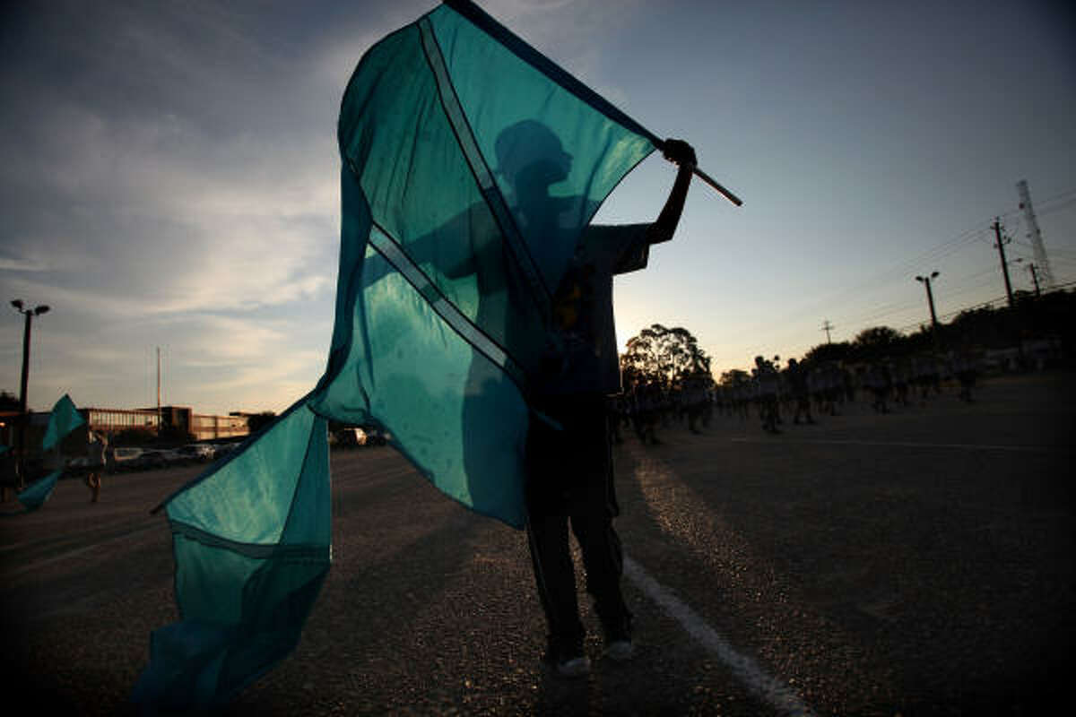 Monica Ruiz, 16, twirls flags during the Waltrip Ram Marching Band early morning rehearsal at Waltrip High School in preparation for the University Interscholastic League's (UIL) Band Competition at Jack F. Rhodes Memorial Stadium in Katy.