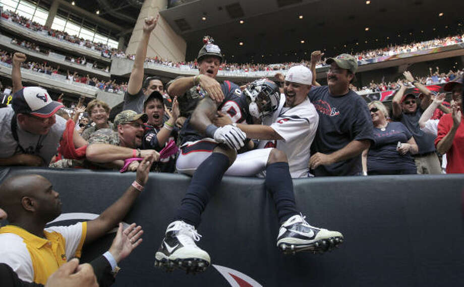 Houston Texans wide receiver Andre Johnson  celebrates in the stands with fans after his game-winning touchdown during the fourth quarter of the Texans victory over the  Kansas City Chiefs at Reliant. Photo: Karen Warren, Chronicle