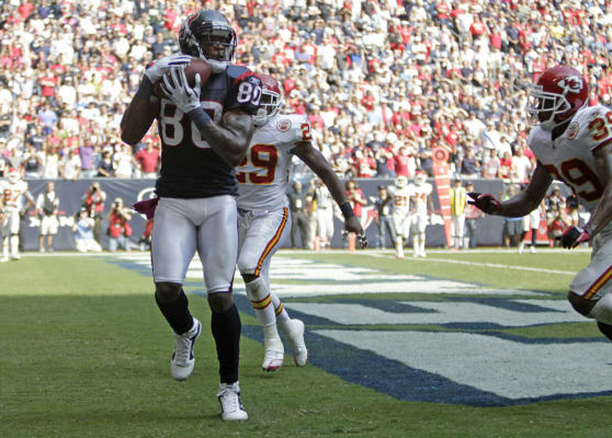 Houston Texans wide receiver Andre Johnson hauls in an 11-yard touchdown pass from Matt Schaub with 28 seconds left to play in the Texans 35-31 victory over the Kansas City Chiefs.