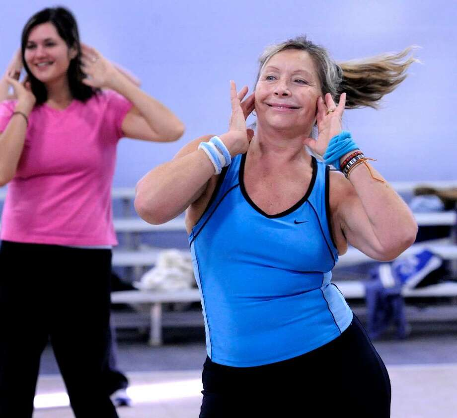 Christina Litwak, of Danbury, works out during Zumba, at the Regional YMCA in Danbury on Tuesday, Oct.6,2009. Photo: Michael Duffy / The News-Times