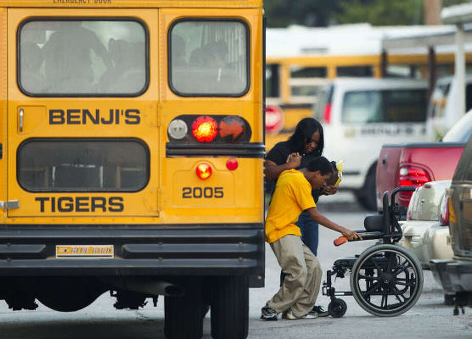 """A pupil is helped at Benji's Special Educational Academy. The state now calls it """"an unaccredited private school."""" Photo: Brett Coomer, Chronicle"""
