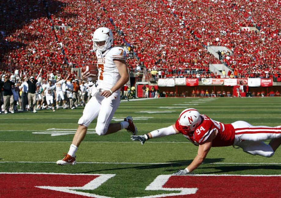 Oct. 16: Texas 20, No. 6 Nebraska 13Texas quarterback Garrett Gilbert runs into the end zone for a first-quarter touchdown. Photo: AP