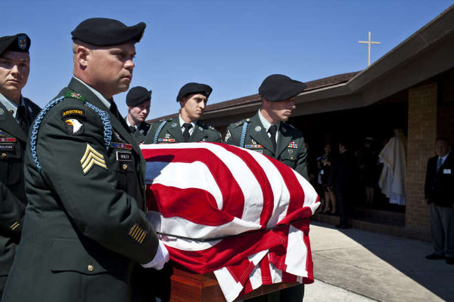 Soldiers bring the casket of David H. McNerney to a hearse following services at Sacred Heart Catholic Church in Crosby. McNerney, a Medal of Honor recipient whose heroics in Vietnam later became the subject of a documentary movie, died Sunday after a battle with lung cancer. He was 79. Photo: Eric Kayne, For The Chronicle
