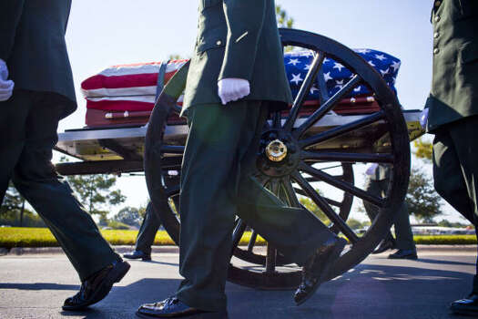 The casket of David H. McNerney is carried on a caisson at the Houston National Cemetery. Photo: Eric Kayne, For The Chronicle