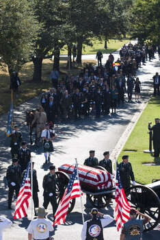 Soldiers transfer the casket of David H. McNerney on a caisson at the Houston National Cemetery. Photo: Eric Kayne, For The Chronicle