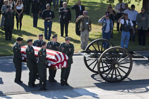 Soldiers transfer the casket of David H. McNerney from a caisson to a service at the Houston National Cemetery. Photo: Eric Kayne, For The Chronicle