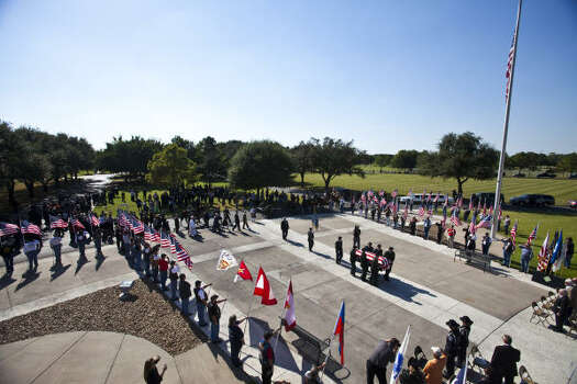 The casket of David H. McNerney is carried to where services will take place at the Houston National Cemetery. Photo: Eric Kayne, For The Chronicle