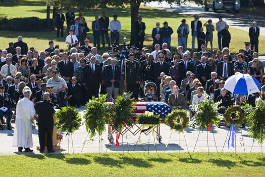 Services are held for David H. McNerney, a Medal of Honor recipient whose heroics in Vietnam later became the subject of a documentary movie, at Houston National Cemetery. Photo: Eric Kayne, For The Chronicle