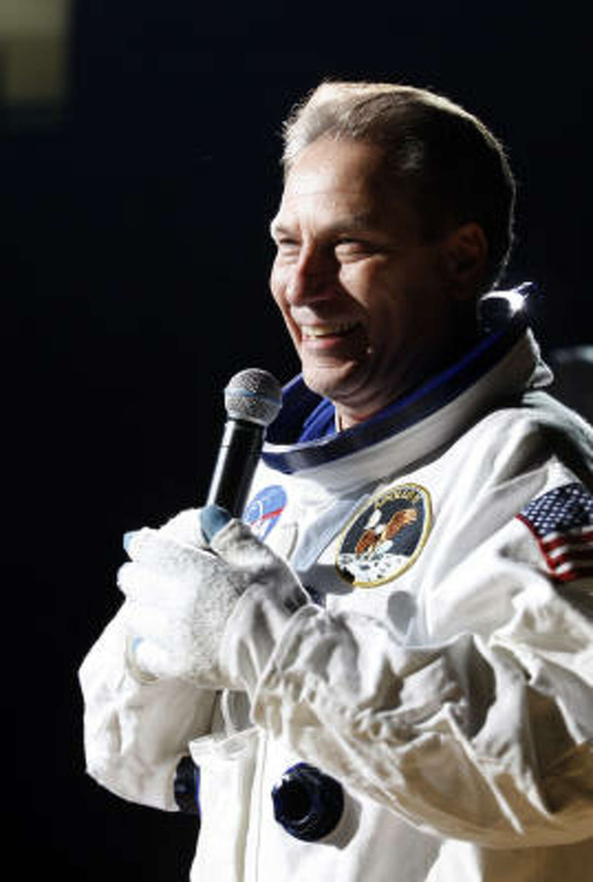 Michigan State coach Tom Izzo speaks to the crowd as an astronaut.
