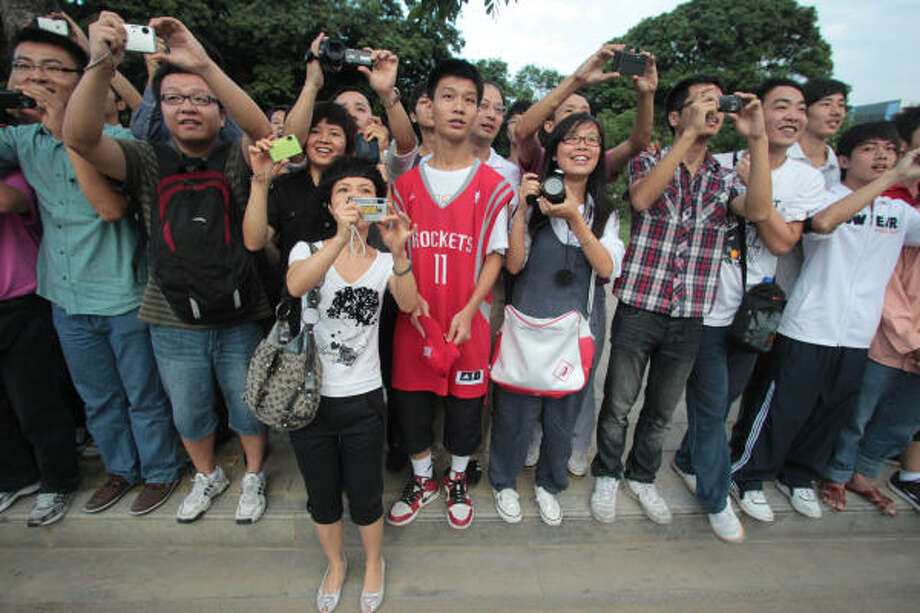 Saturday, Oct. 16 Hundreds of fans take photos as Yao Ming's Houston Rockets bus arrives before the New Jersey Nets preseason match-up for the NBA China Games at the Guangzhou International Sports Arena. Photo: Billy Smith II, Chronicle