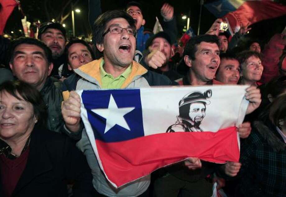 Chileans celebrate as the mine rescue comes to an end. Photo: Martin Mejia, Associated Press