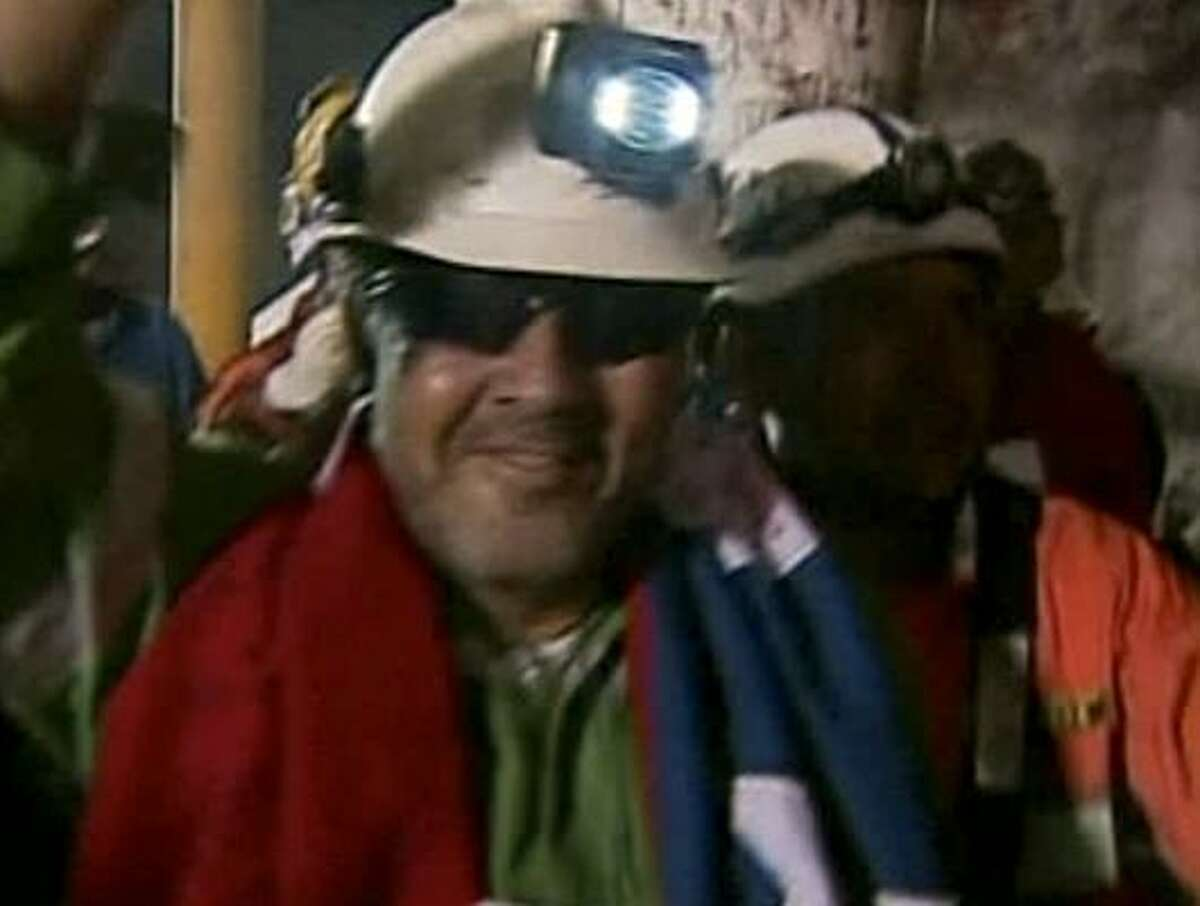 In this screen grab from video, Luis Urzua, the final miner to be rescued, is all smiles.